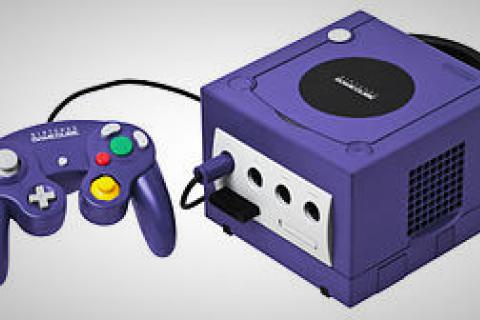 Gamecube w/ two controllers, memory card, and 4 games Photo