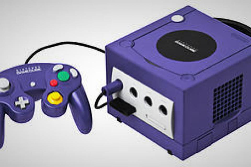 Gamecube w/ two controllers, memory card, and 4 games Large Photo