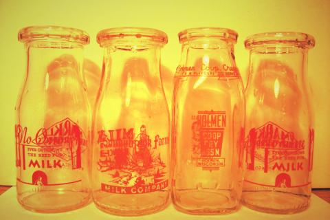 4 Vintage Milk Bottles Photo