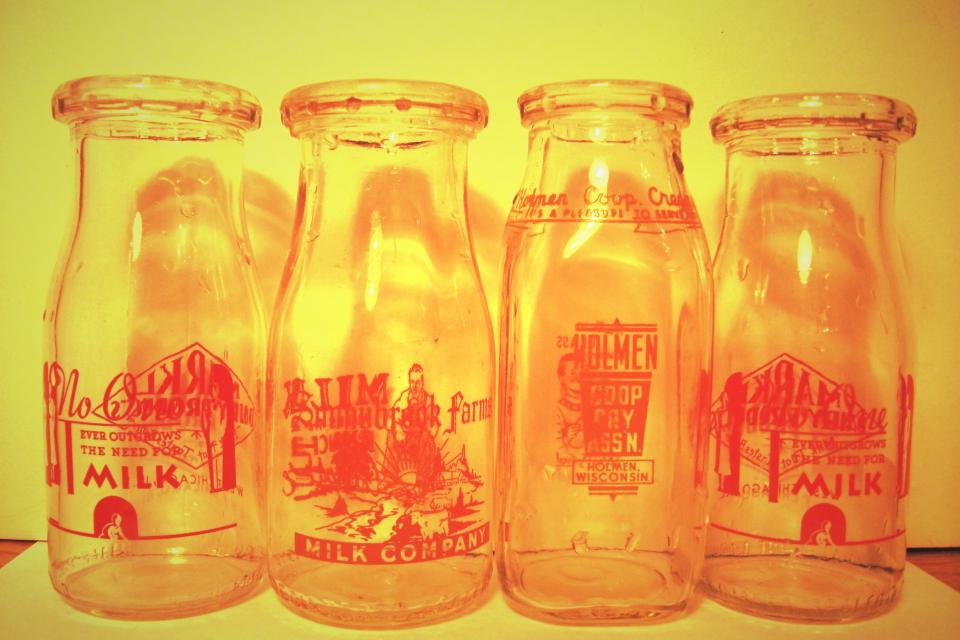 4 Vintage Milk Bottles Large Photo