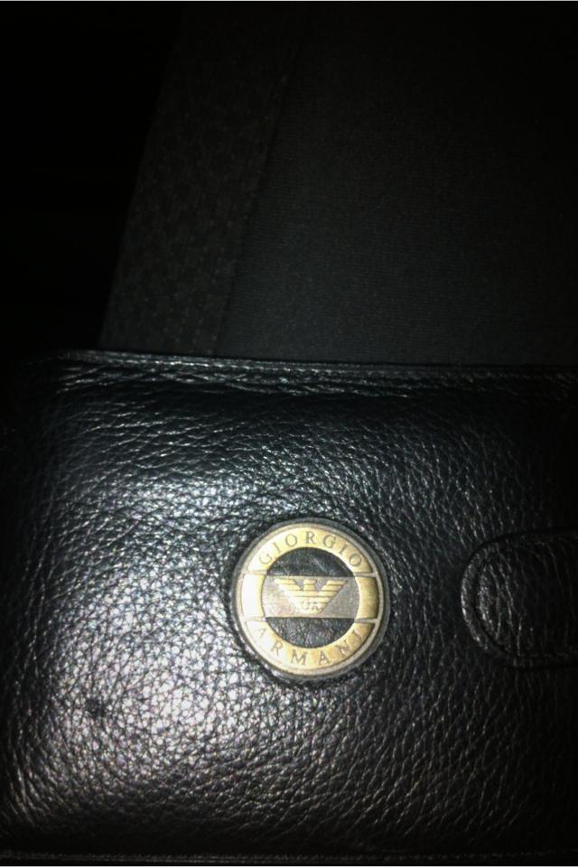 Giorgio Armani black men's wallet.  Photo