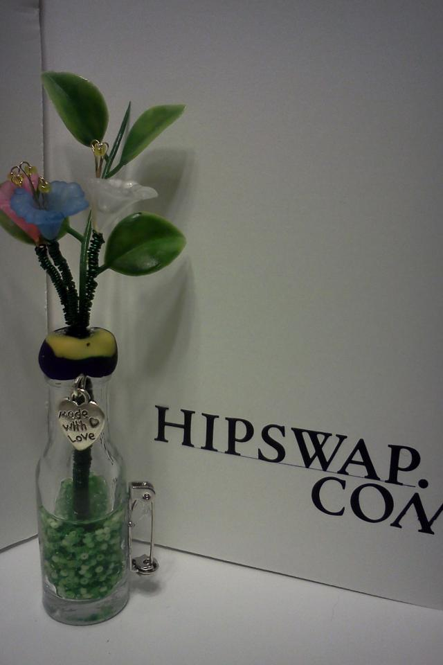 Handmade beaded flowers in glass bottles pins Photo