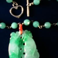 Vintage 16 inch jade necklace with two koi fish on the sides Photo