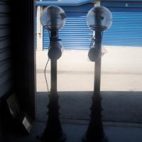 2 TALL OUTDOOR PATIO LIGHTS 512-662-4811  Photo