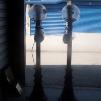 2 TALL OUTDOOR PATIO LIGHTS 512-662-4811  Photo