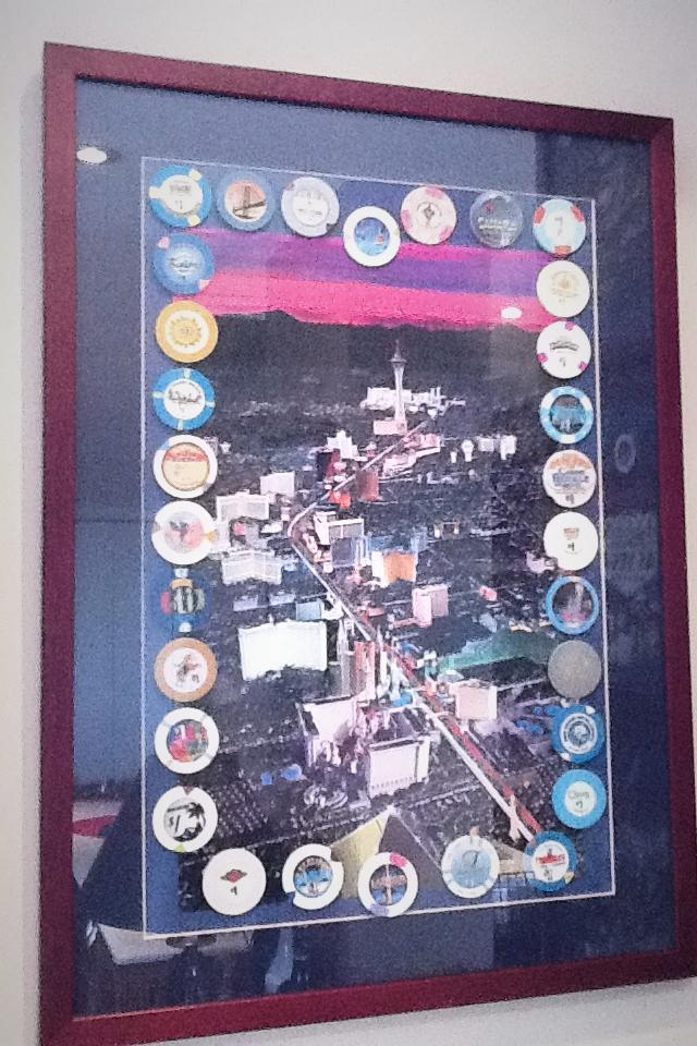 Framed strip print with casino chips  Photo