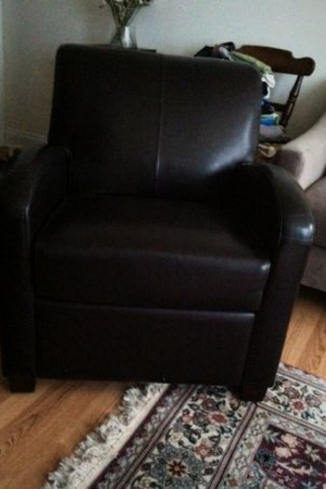 faux-leather club chair  Photo