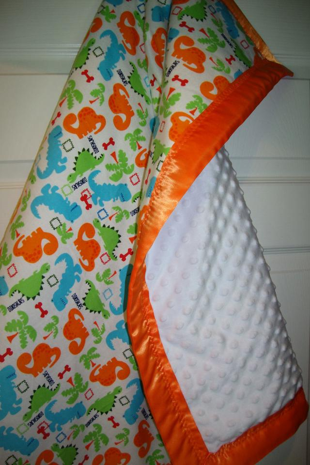 Baby Blanket with Cute Little Baby Dinosaurs and a Ultra Soft Minky Fabric Photo