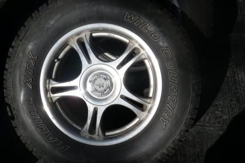 235/70R16 WILD COUNTRY all season radial tires on rims Photo