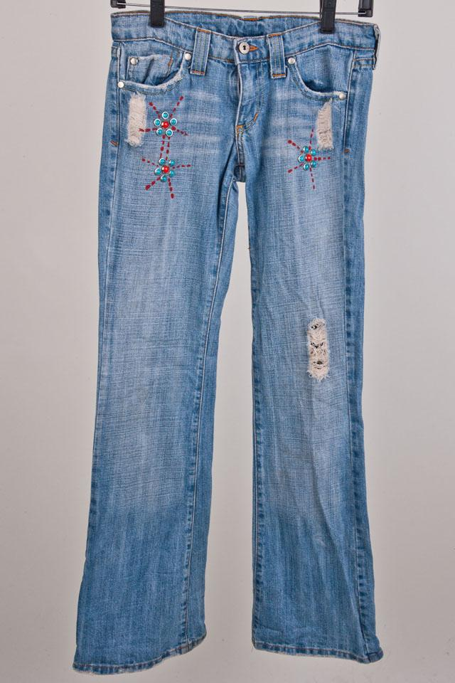 Jeans with Blue and Red Stud Designs Photo