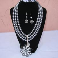 Silver star gray pearl center pendant with gray imitation tripple loop pearl beaded necklace and matching earrings Photo