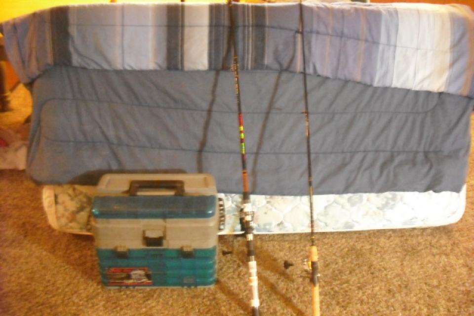 Fishing poles and tackle Large Photo