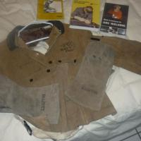 Welding jacket, gloves, books Photo