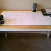 White tile and wood table Photo