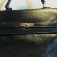 Gorgeous big vintage black leather handbag. Kelly model. Photo