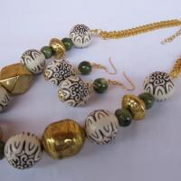 White ivory color african design with jade color and gold metal accented beaded necklace Photo