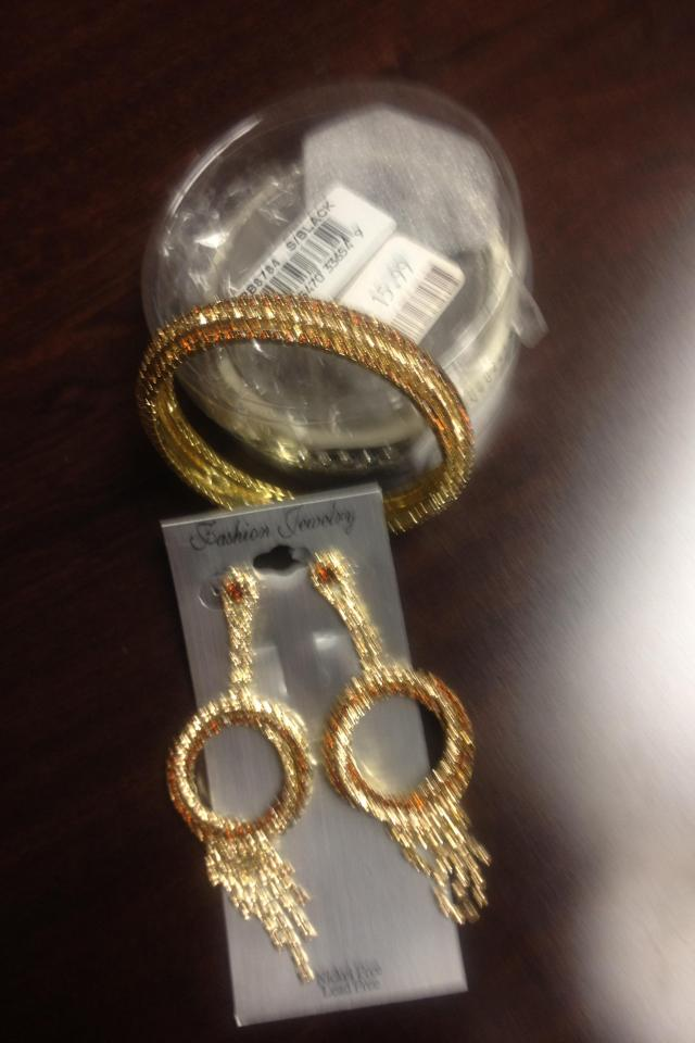 Golden bracelet and earring  Photo