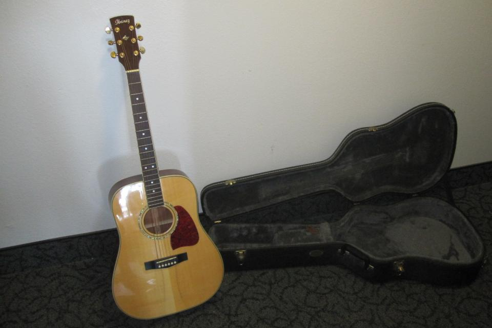Hand Crafted Ibanez Acoustic Guitar with Hard Case and Electrical Tuner Large Photo