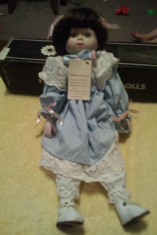 untouched porcelain doll Photo
