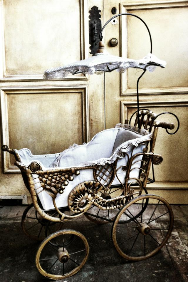 Vintage style baby carriage Photo