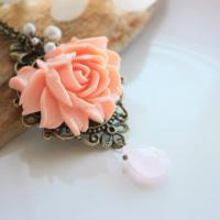 Trendy Rose Necklace from Europe with decorative pearls and antique style chain Photo