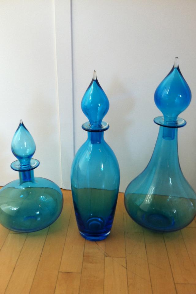 3 blue decorative bottles with tops Photo