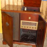 Vintage mahogany record player and radio Photo