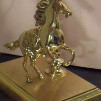 gilded lamp with a  horse and a metal shade. Photo