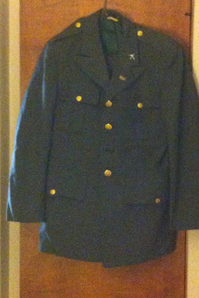 Vintage U.S. Army Uniform. Jacket and slacks with pins Photo