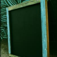 Blue and green wood framed chalkboard Photo