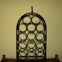 Antique wrought iron black wine rack Photo