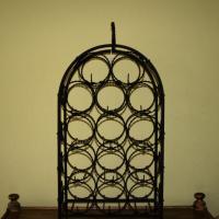 Antique wrought iron black wine rack Photo