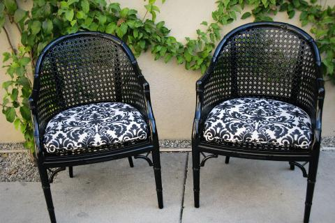 Pair of Black Chairs w/ Black and White Floral Cushions Photo