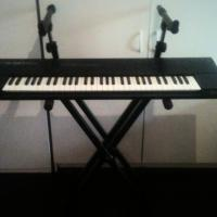 roland s-50 keyboard and two tier stand Photo