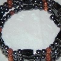 Hemitite magnetic beads with goldstone rounds. Photo
