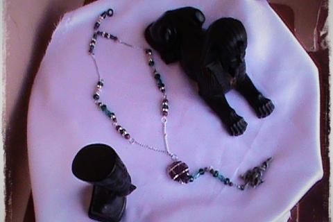 Fantasy sword and snake rosary design fashion necklace done by artist. Photo